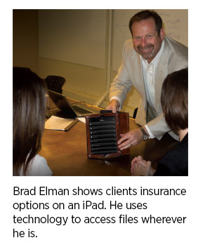Brad-Elman-shows-clients-insurance-options-on-iPad.jpg